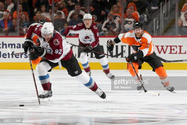 Gabriel Landeskog of the Colorado Avalanche skates past Claude Giroux of the Philadelphia Flyers during the third period at Wells Fargo Center on...
