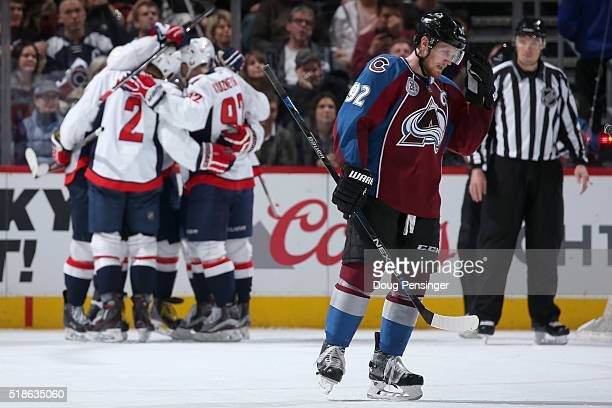 Gabriel Landeskog of the Colorado Avalanche skates to the bench as the Washington Capitals celebrate a goal by Alex Ovechkin of the Washington...