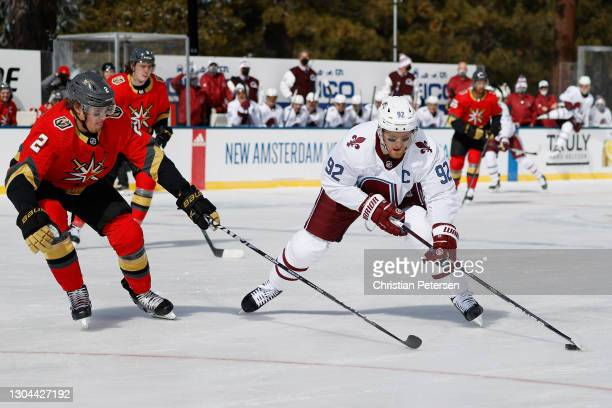 Gabriel Landeskog of the Colorado Avalanche skates with the puck against Zach Whitecloud of the Vegas Golden Knights during the 'NHL Outdoors At Lake...