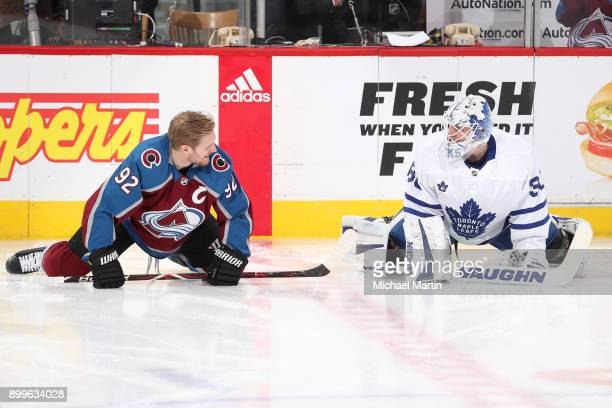 Gabriel Landeskog of the Colorado Avalanche talks to goaltender Calvin Pickard of the Toronto Maple Leafs during warm ups at the Pepsi Center on...