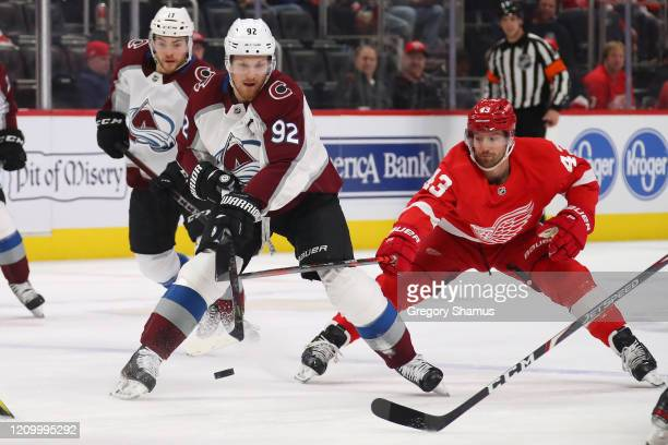 Gabriel Landeskog of the Colorado Avalanche tries to get around the stick of Darren Helm of the Detroit Red Wings during the first period at Little...
