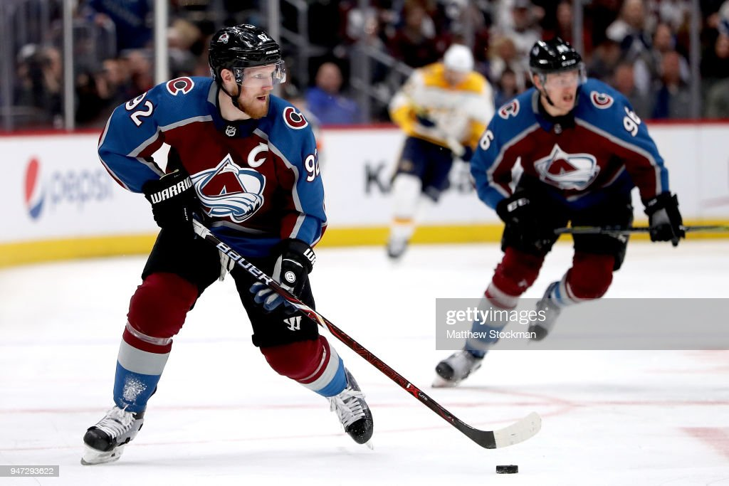 Gabriel Landeskog #92 of the Colorado Rockies brings the puck down the ice against the Nashville Predators in Game Three of the Western Conference First Round during the 2018 NHL Stanley Cup Playoffs at the Pepsi Center on April 16, 2018 in Denver, Colorado.