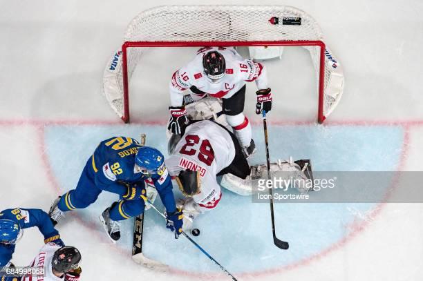 Gabriel Landeskog tries to score against Goalie Leonardo Genoni and Raphael Diaz during the Ice Hockey World Championship Quarterfinal between...