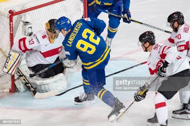 Gabriel Landeskog tries to score against Goalie Leonardo Genoni during the Ice Hockey World Championship Quarterfinal between Switzerland and Sweden...