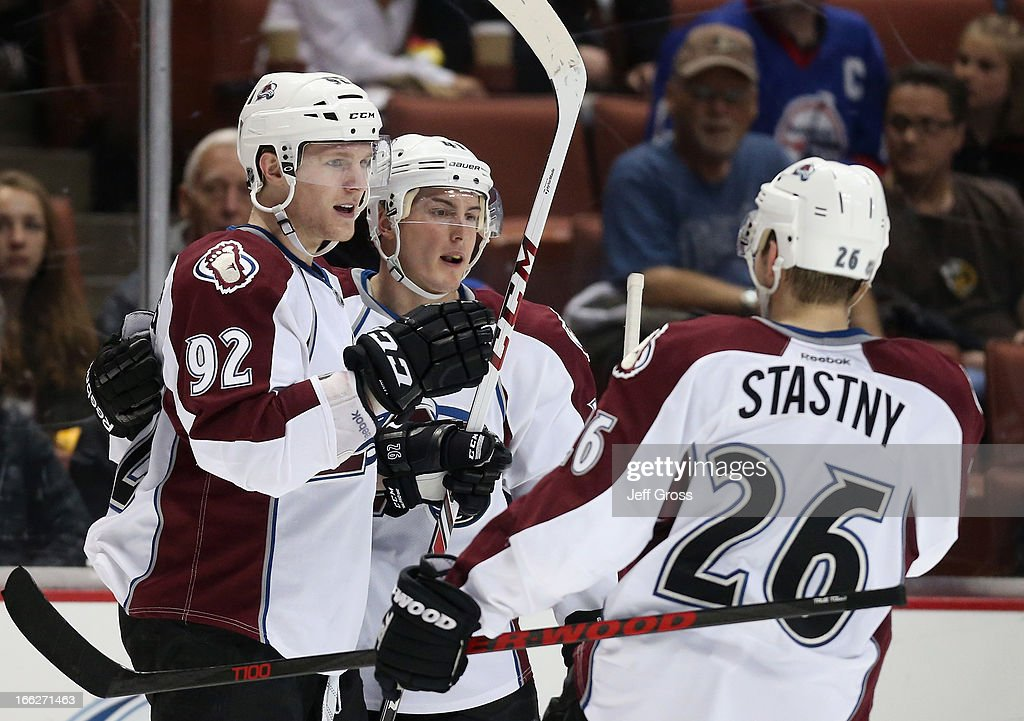Gabriel Landeskog #92; Tyson Barrie #41 and Paul Stastny #26 of the Colorado Avalanche celebrate Landeskog's shorthanded goal against the Anaheim Ducks in the second period at Honda Center on April 10, 2013 in Anaheim, California. The Avalanche defeated the Ducks 4-1.