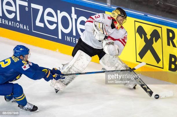 Gabriel Landeskog vies with Goalie Leonardo Genoni during the Ice Hockey World Championship Quarterfinal between Switzerland and Sweden at...