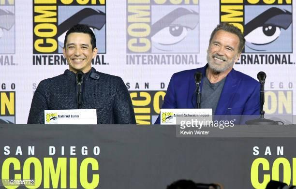 Gabriel Luna and Arnold Schwarzenegger speak at the Terminator Dark Fate panel during 2019 ComicCon International at San Diego Convention Center on...