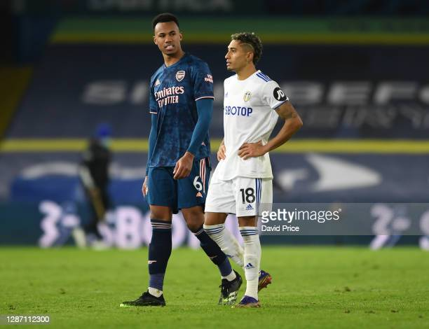Gabriel Magalhaes of Arsenal chats to Raphinha of Leeds after the Premier League match between Leeds United and Arsenal at Elland Road on November...