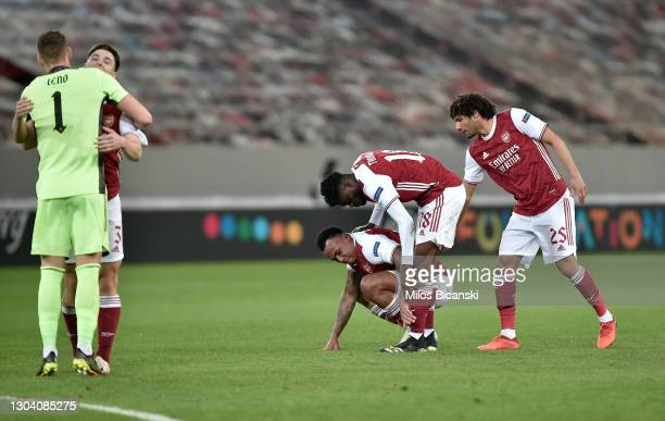 Gabriel Magalhaes, Thomas Partey and Mohamed Elneny of Arsenal celebrate following their team's victory in the UEFA Europa League Round of 32 match...