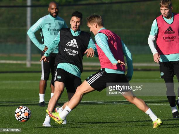 Gabriel Martinelli and Martin Odegaard of Arsenal during the Arsenal 1st team training session at London Colney on October 21, 2021 in St Albans,...