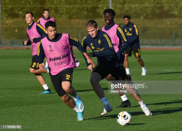 Gabriel Martinelli and Rob Holding of Arsenal during the Arsenal Training Session and Press Conference at London Colney on October 02 2019 in St...