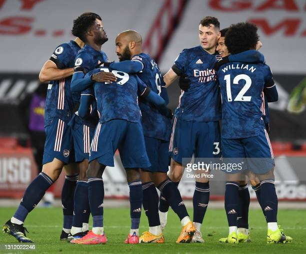 Gabriel Martinelli celebrates scoring Arsenal's 2nd goal with Granit Xhaka and Willian during the Premier League match between Sheffield United and...