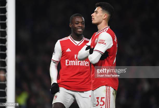 Gabriel Martinelli celebrates scoring the 1st Arsenal goal with Nicolas Pepe during the Premier League match between Chelsea FC and Arsenal FC at...