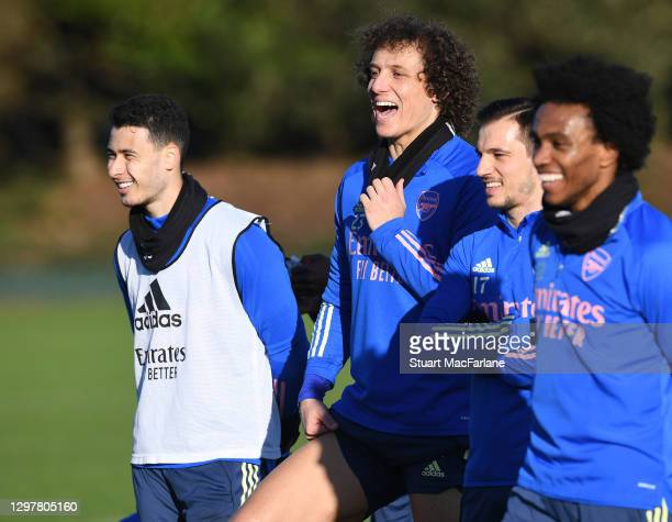 Gabriel Martinelli, David Luiz and Cedric of Arsenal during a training session at London Colney on January 22, 2021 in St Albans, England.