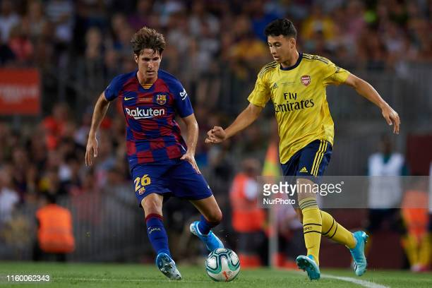 Gabriel Martinelli of Arsenal and Juan Miranda of Barcelona competes for the ball during the Joan Gamper trophy match between FC Barcelona and...