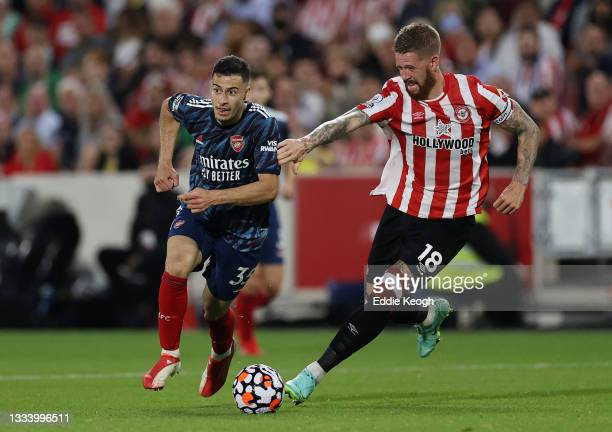 Gabriel Martinelli of Arsenal and Pontus Jansson of Brentford battle for the ball during the Premier League match between Brentford and Arsenal at...