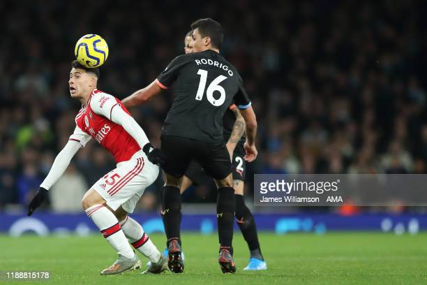 Gabriel Martinelli of Arsenal and Rodrigo of Manchester City during the Premier League match between Arsenal FC and Manchester City at Emirates...