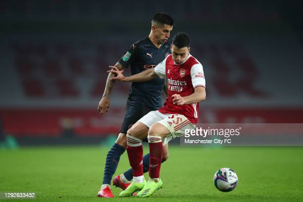 Gabriel Martinelli of Arsenal battles for possession with Joao Cancelo of Manchester City during the Carabao Cup Quarter Final match between Arsenal...