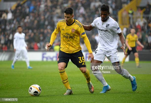 Gabriel Martinelli of Arsenal battles for possession with Mikel Agu of Vitoria Guimaraes during the UEFA Europa League group F match between Vitoria...