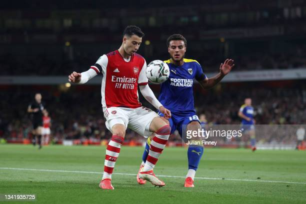 Gabriel Martinelli of Arsenal battles for possession with Nesta Guinness-Walker of AFC Wimbledon during the Carabao Cup Third Round match between...