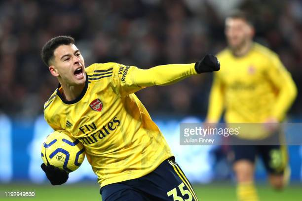 Gabriel Martinelli of Arsenal celebrates after scoring his sides first goal during the Premier League match between West Ham United and Arsenal FC at...