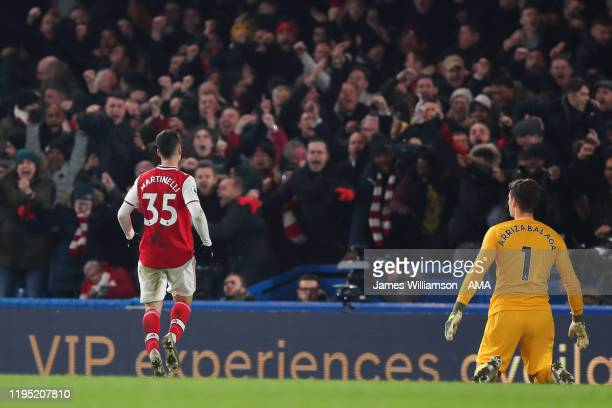 Gabriel Martinelli of Arsenal celebrates towards the Arsenal fans after scoring a goal to make it 11 during the Premier League match between Chelsea...