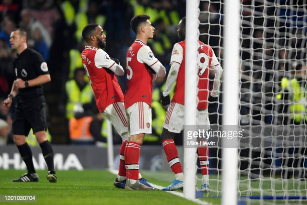 Gabriel Martinelli of Arsenal celebrates with his team mates after scoring his team's first goal during the Premier League match between Chelsea FC...