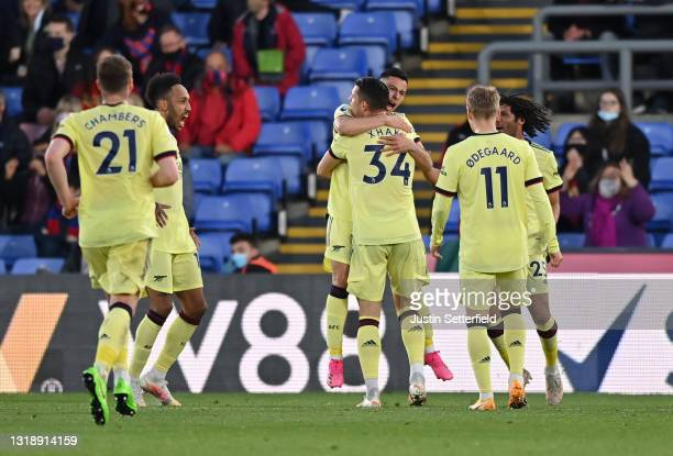 Gabriel Martinelli of Arsenal celebrates with team mates Granit Xhaka, Martin Odegaard, and Mohamed Elneny after scoring his team's second goal...