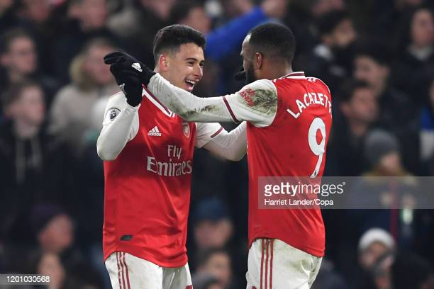 Gabriel Martinelli of Arsenal celebrates with teammate Alexandre Lacazette after scoring his team's first goal during the Premier League match...