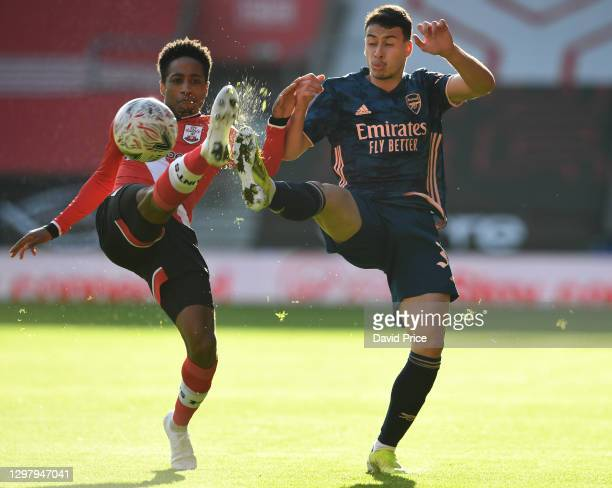 Gabriel Martinelli of Arsenal challenges Kyle Walker-Peters of Southampton for the ball during the FA Cup 4th round match between Southampton and...