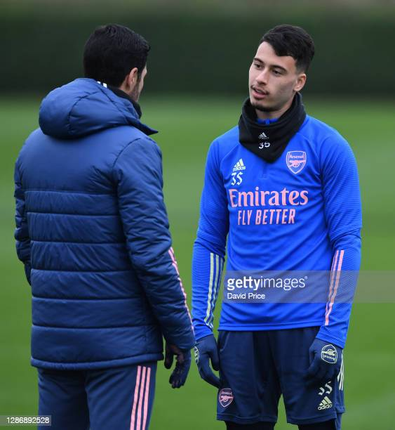Gabriel Martinelli of Arsenal chats to Arsenal Manager Mikel Arteta during the Arsenal 1st team training session at London Colney on November 21 2020...