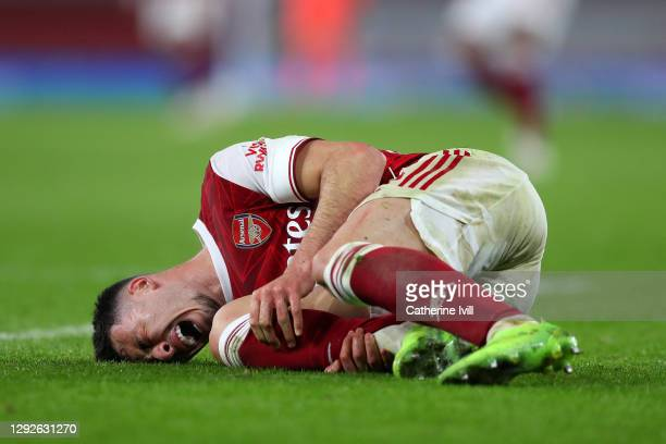 Gabriel Martinelli of Arsenal goes down injured during the Carabao Cup Quarter Final match between Arsenal and Manchester City at Emirates Stadium on...