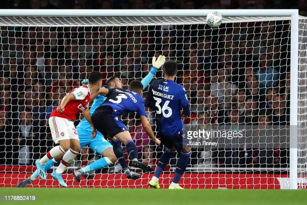 Gabriel Martinelli of Arsenal heads the ball and score the first goal of the game during the Carabao Cup Third Round match between Arsenal FC and...