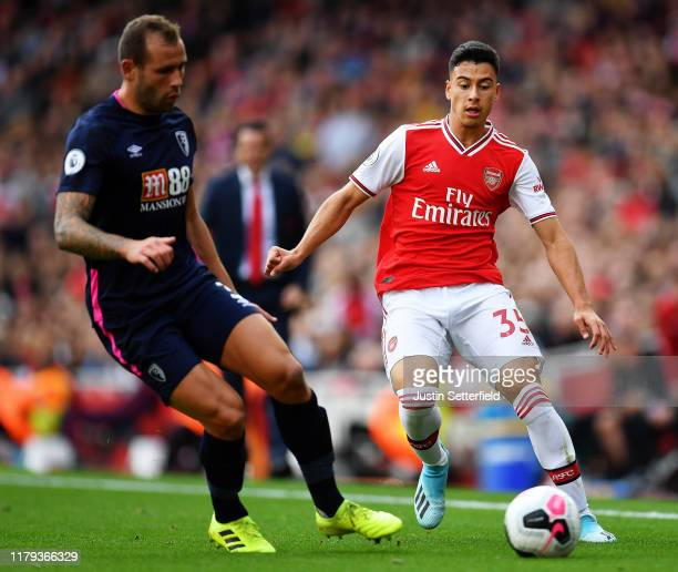 Gabriel Martinelli of Arsenal is challenged by Steve Cook of AFC Bournemouth during the Premier League match between Arsenal FC and AFC Bournemouth...