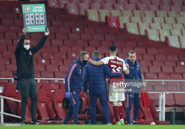 Gabriel Martinelli of Arsenal is helped off as he replaced due to injury during the Carabao Cup Quarter Final match between Arsenal and Manchester...