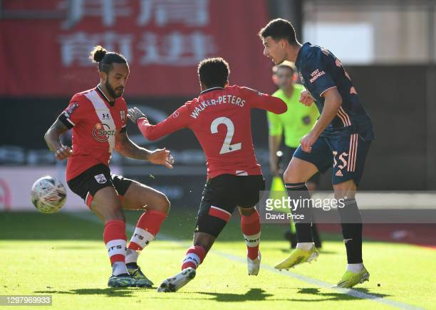 Gabriel Martinelli of Arsenal passes the ball between Theo Walcott and Kyle Walker-Peters of Southampton during the FA Cup 4th round match between...