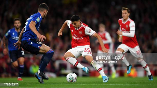 Gabriel Martinelli of Arsenal runs at Tobias Figueiredo of Nottingham Forest during the Carabao Cup Third Round match between Arsenal FC and...