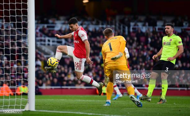 Gabriel Martinelli of Arsenal scores his sides first goa during the Premier League match between Arsenal FC and Sheffield United at Emirates Stadium...