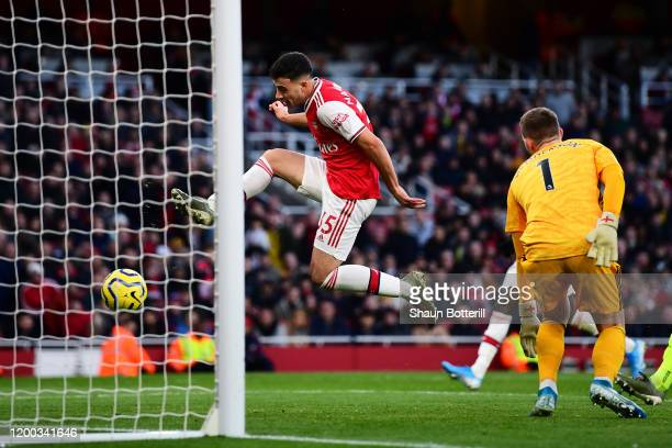Gabriel Martinelli of Arsenal scores his sides first goal during the Premier League match between Arsenal FC and Sheffield United at Emirates Stadium...