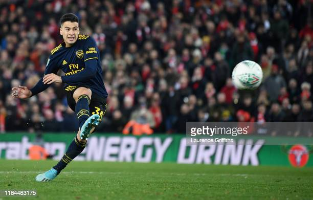 Gabriel Martinelli of Arsenal scores his sides third penalty during the penalty shoot out during the Carabao Cup Round of 16 match between Liverpool...