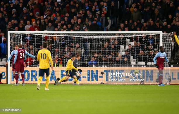 Gabriel Martinelli of Arsenal scores his teams first goal during the Premier League match between West Ham United and Arsenal FC at London Stadium on...