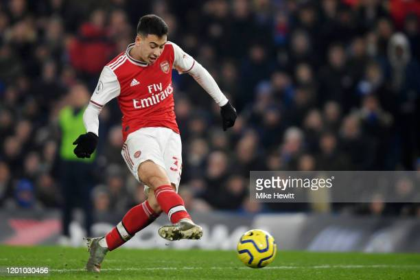 Gabriel Martinelli of Arsenal scores his team's first goal during the Premier League match between Chelsea FC and Arsenal FC at Stamford Bridge on...