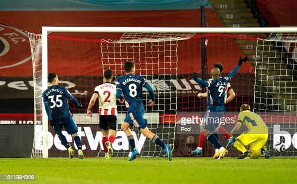 Gabriel Martinelli of Arsenal scores their side's second goal past Aaron Ramsdale of Sheffield United during the Premier League match between...