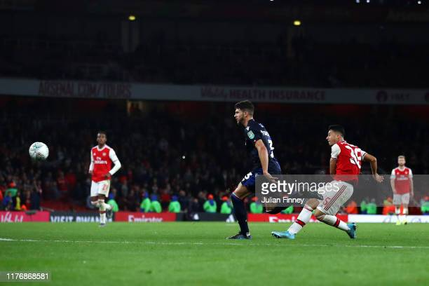 Gabriel Martinelli of Arsenal shoots and scores a goal during the Carabao Cup Third Round match between Arsenal FC and Nottingham Forrest at Emirates...