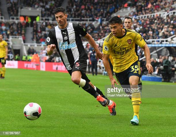 Gabriel Martinelli of Arsenal takes on Fabian Schar of Newcastle during the Premier League match between Newcastle United and Arsenal FC at St James...
