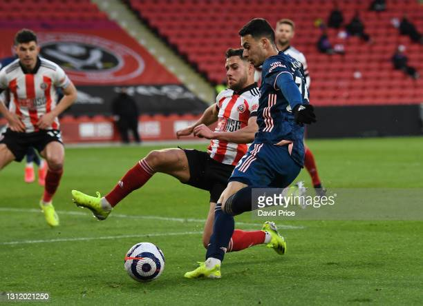 Gabriel Martinelli of Arsenal takes on George Baldock of Sheffield United during the Premier League match between Sheffield United and Arsenal at...