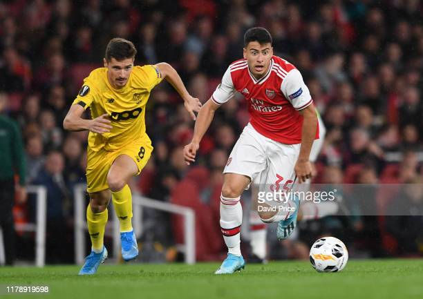 Gabriel Martinelli of Arsenal takes on Gojko Cimirot of Liege during the UEFA Europa League group F match between Arsenal FC and Standard Liege at...