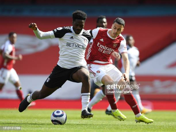 Gabriel Martinelli of Arsenal takes on Ola Aina of Fulham during the Premier League match between Arsenal and Fulham at Emirates Stadium on April 18,...