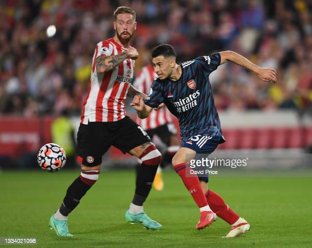 Gabriel Martinelli of Arsenal takes on Pontus Jansson of Brentford during the Premier League match between Brentford and Arsenal at Brentford...