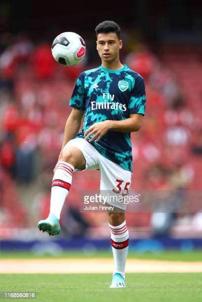 Gabriel Martinelli of Arsenal warms up during the Premier League match between Arsenal FC and Burnley FC at Emirates Stadium on August 17 2019 in...